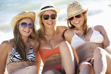 sunglasses beach: Group Of Teenage Girls Enjoying Beach Holiday Together Stock Photo