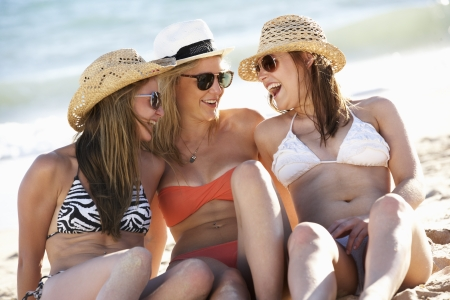 girl swimming: Group Of Teenage Girls Enjoying Beach Holiday Together Stock Photo