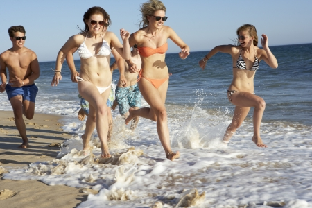 boy 18 year old: Group Of Teenage Friends Enjoying Beach Holiday Together