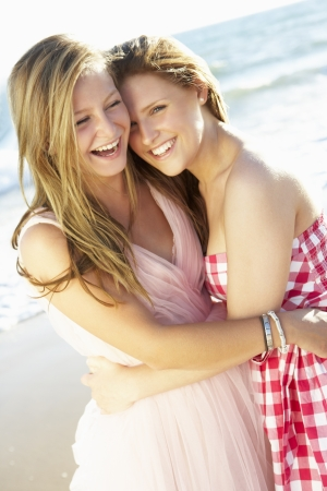 Two Teenage Girls Enjoying Beach Holiday Together photo