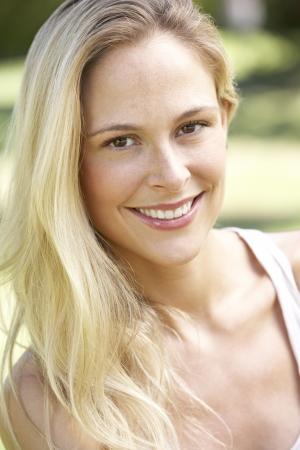 thirties portrait: Outdoor Portrait Of Smiling Woman