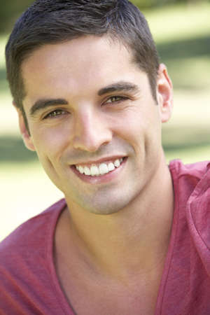 head shoulders: Outdoor Portrait Of Smiling Young Man Stock Photo