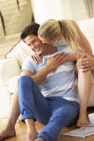 love kissing: Couple Relaxing On Sofa At Home