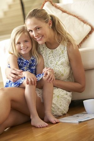 Mother Relaxing At Home With Daughter photo