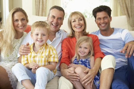 family looking up: Multi Generation Family Relaxing On Sofa At Home Stock Photo