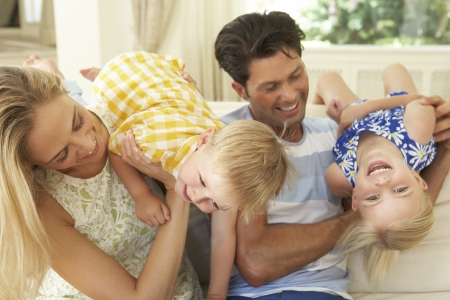 Family Playing On Sofa At Home photo