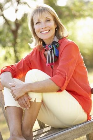 one senior: Senior Woman Sitting Outdoors On Bench