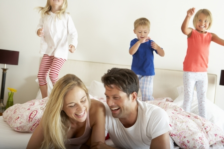 3 year old boy: Family Relaxing Together In Bed