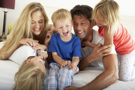 Family Relaxing Together In Bed Stock Photo - 18723164
