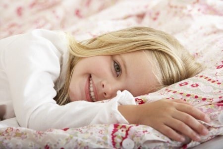 Young Girl Relaxing On Bed photo