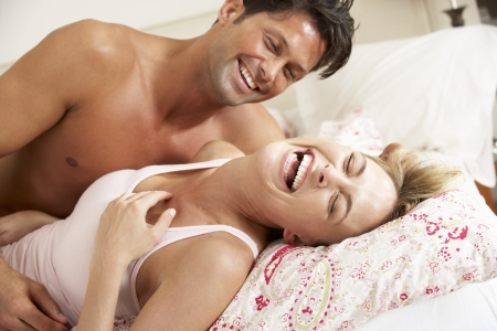 couple cuddling: Couple Relaxing Together In Bed
