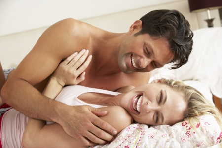 affectionate: Couple Relaxing Together In Bed