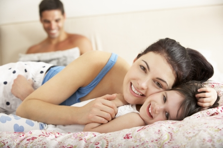 Family Relaxing In Bed Together Stock Photo - 18718801