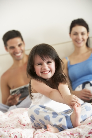 Family Relaxing In Bed Together Stock Photo - 18718800