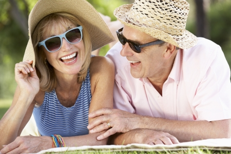 Senior Couple Relaxing In Summer Garden photo