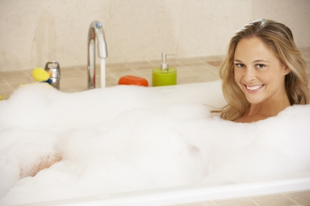 woman bath: Woman Relaxing In Bubble Filled Bath Stock Photo