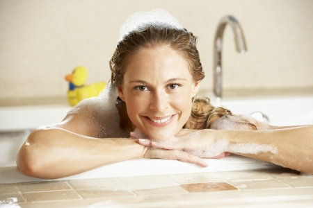 Woman Relaxing In Bubble Filled Bath Stock Photo - 18719707