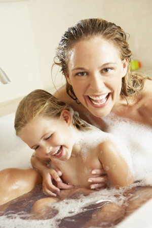 daughter: Mother And Daughter Relaxing In Bubble Filled Bath Stock Photo