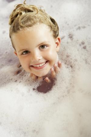 5 year old girl: Girl Playing In Bath Stock Photo