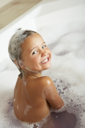 child bath: Girl Playing In Bath Stock Photo