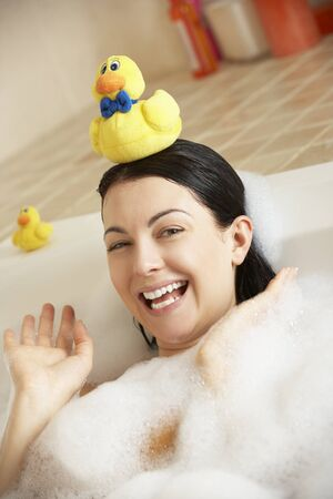 Woman Relaxing In Bubble Filled Bath Stock Photo - 18719144