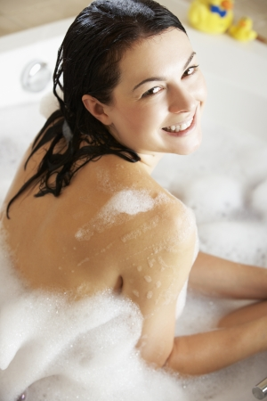 Woman Relaxing In Bubble Filled Bath Stock Photo - 18719128