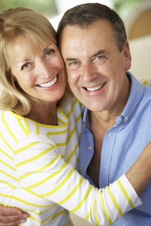 Romantic Portrait Of Senior Couple Indoors photo