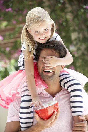 marshmallows: Father Giving Daughter Ride On Shoulders Outdoors Whilst Eating Marshmallows