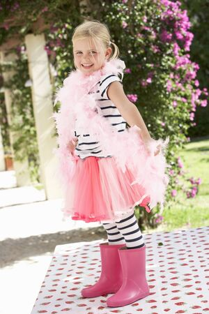 feather boa: Young Girl Wearing Pink Wellington And Feather Boa
