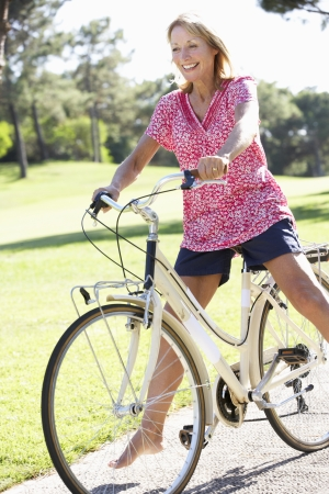 cycle ride: Senior Woman Enjoying Cycle Ride