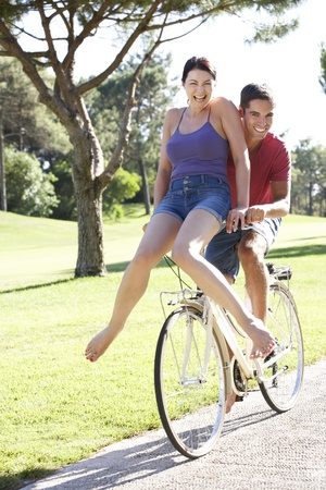 Couple Enjoying Cycle Ride Stock Photo - 18723264