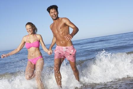 women and men: Couple Enjoying Beach Holiday