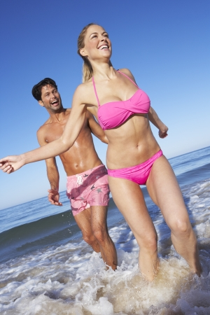 Couple Enjoying Beach Holiday photo