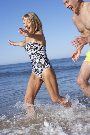 swimshorts: Senior Couple Enjoying Beach Holiday Stock Photo