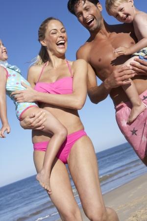 Family Having Fun On Beach photo