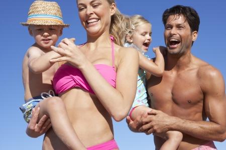 child bikini: Family Having Fun On Beach Stock Photo
