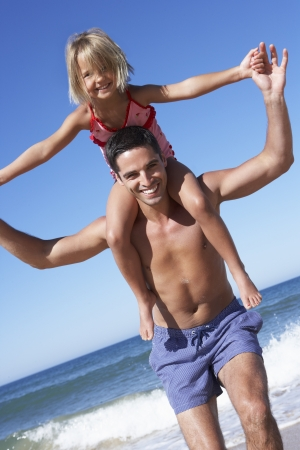 5 year old girl: Father And Daughter Having Fun On Beach Stock Photo