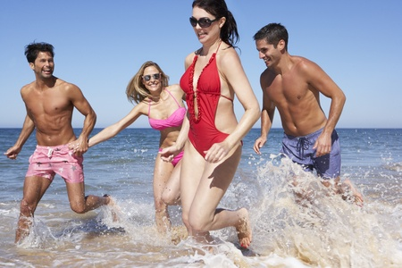 swimshorts: Group Of Friends Enjoying Beach Holiday