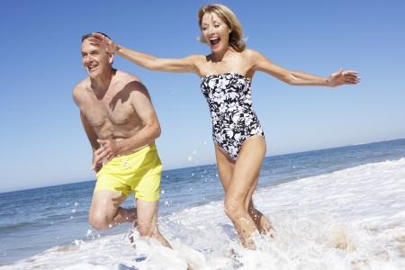 Senior Couple Enjoying Beach Holiday Stock Photo - 18720975