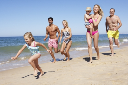 swimshorts: Multi Generation Family Enjoying Beach Holiday