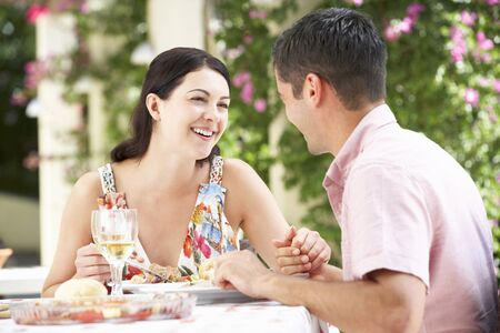 Couple Enjoying Meal outdoorss photo