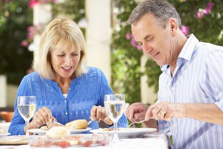 Senior Couple Enjoying Meal outdoorss photo