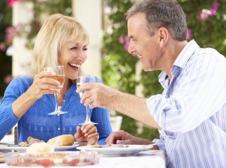 Senior Couple Enjoying Meal outdoorss photo