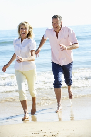 active holiday: Senior Couple Enjoying Romantic Beach Holiday