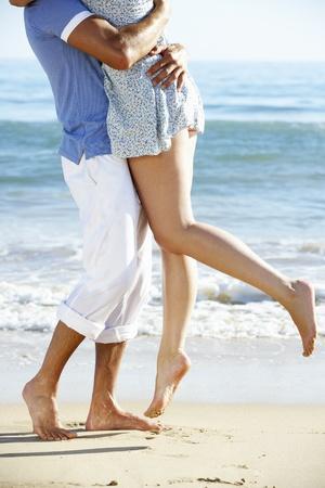 piernas hombre: Pareja disfrutando de vacaciones en Playa Rom�ntica