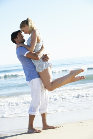 Couple Enjoying Romantic Beach Holiday photo