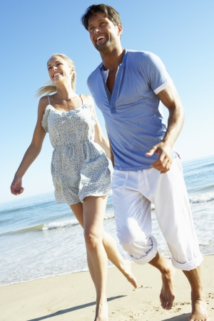 thirties: Couple Enjoying Romantic Beach Holiday Stock Photo