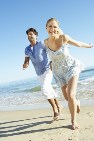 30s: Couple Enjoying Romantic Beach Holiday Stock Photo