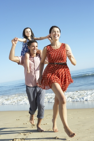 Family Having Fun On Beach photo