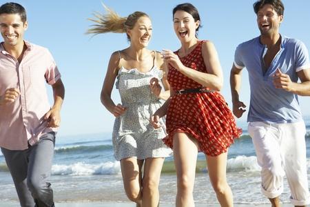 four friends: Group Of Friends Enjoying Beach Holiday